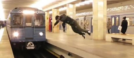 Crazy Russian guy Frontflips in front of Oncoming Train